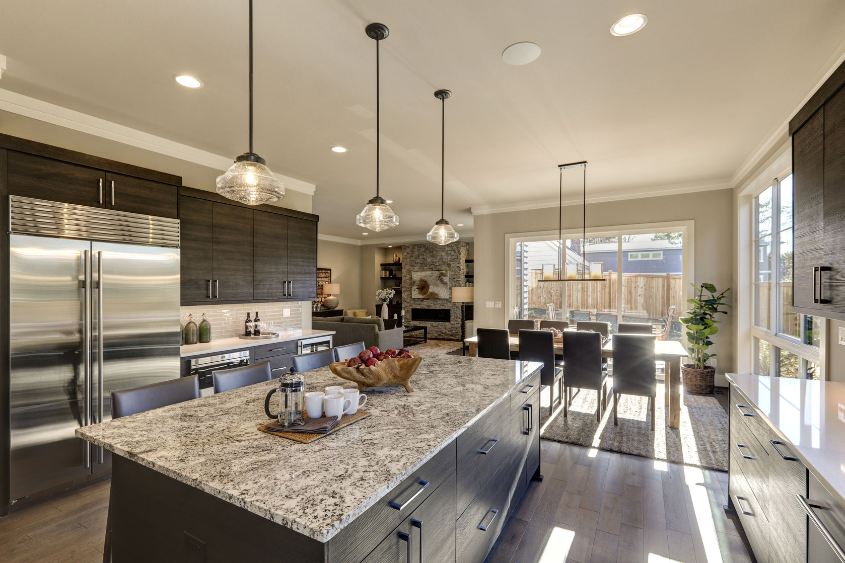 Modern Kitchen Remodel Featuring Gray Flat Front Cabinetry Paired With  White Quartz Countertops And A Tile Backsplash With A Granite Kitchen  Island.